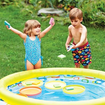 Toss balls or sponges  into upside down frisbees for pool game......do this while in the pool