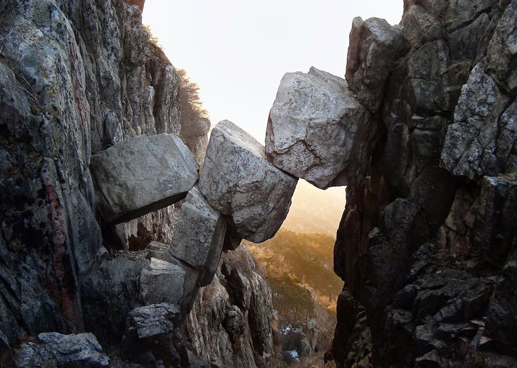 The Immortal Bridge, Mount Tai, Shandong, China. Immortal Bridge is basically a bridge that is made of three big rocks and several little ones, so it's actually not a bridge that is made by humans. Some say that the Immortal Bridge has been standing like this since the last ice ages, maybe that's why the name sounds like that. Pretty impressive that it is that old! #travel #china #asia
