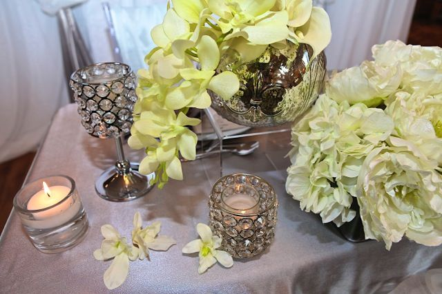 silk orchids and peonies with crystal candle holders; design by Davis Floral Creations