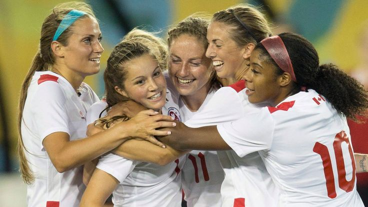 July 11 - Football - Women - First Round. Members of the Canada women's football team celebrate one of Janine Beckie's goals in a 5-2 Pan Am Games win over Ecuador.