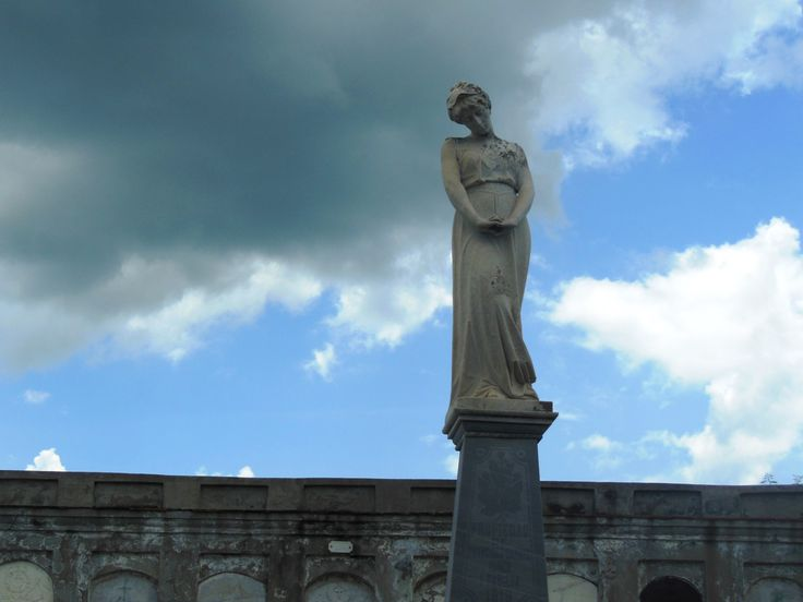 One of many statues rising above the tombs at Cementerio General La Reina, a national monument in Cienfuegos. The neo-Classical style cemetery dates from the 1830s and contains the graves of soldiers from the independence wars. (Photo by Kathryn MacDonald)