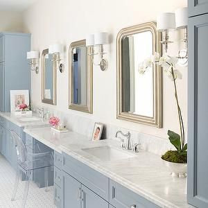 Hallie Henley Design - bathrooms - blue cabinets, blue bath cabinets, blue bathroom cabinets, blue sink vanity, blue washstands, his and her vanities, his and her washstands, marble countertops, drop down vanity, blue make up vanity, blue dressing table, built in make up vanity, built in dressing table, arched mirrors, silver arched mirrors, beaded mirrors, beaded vanity mirrors, ballard designs mirrors, 2 light sconces, acrylic vanity chair, blue linen cabinets, vintage hex tiles, white and…