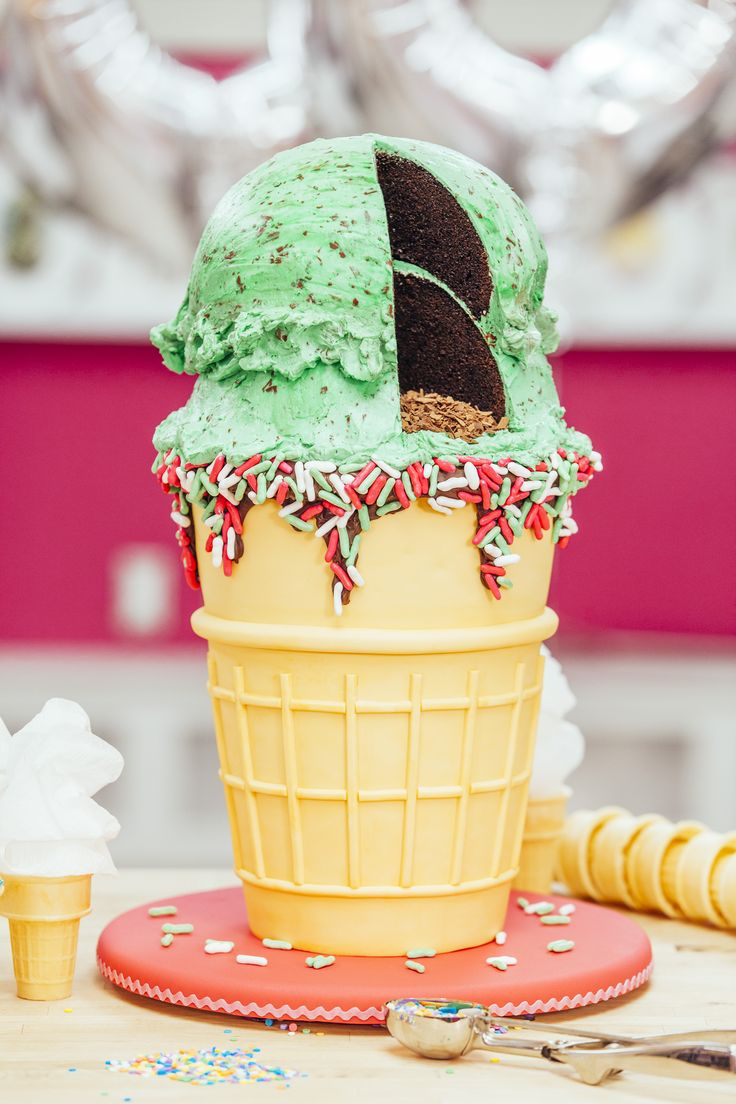 A fondant-wrapped vanilla cake cone with two scoops of chocolate cake, covered in mint chocolate chip buttercream. My perfect Birthday treat :) #Cakes #Baking #Dessert