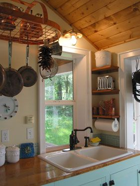 Tiny cottage kitchen - a well organized galley kitchen functions better than an unorganized large kitchen