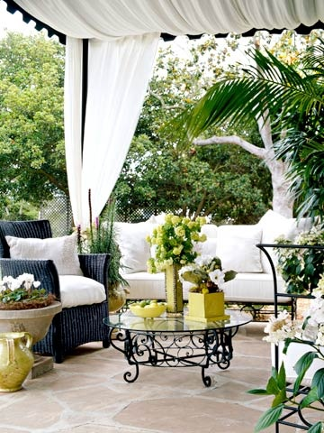love the pops of green and the blue wicker chair