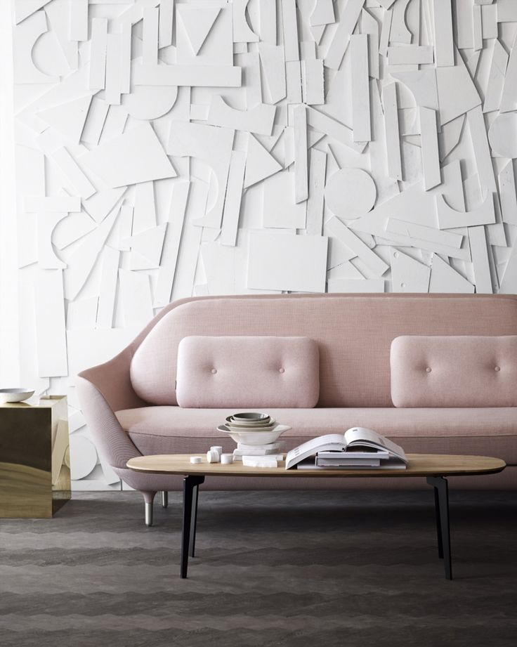 Fritz Hansen - Favn™ sofa by Jaime Hayon. The Favn™ sofa comes in a selection of unique Designer Selections colours in a mix of 3 fabrics; one fabric for the shell, a second for the seat and back cushions, and a third fabric for the small decorative cushions.