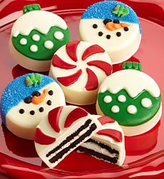 Fa La La Holiday Oreos - Fa La La Oreos. Send a favorite someone a holiday goodie box filled with six delicious and festively fun Oreo sandwich cookies covered in creamy confection decoration as snowmen, Christmas tree ornaments and peppermint candies! First they'll smile, and then they'll bite into the deliciousness beneath the creamy covering and taste the classic chocolate cookie goodness and sweet cream of a classic Oreo sandwich cookie. Season's Greetings just got a whole lot sweeter…