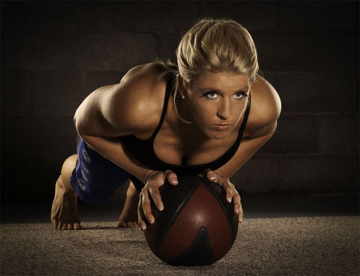 Any kind of medicine ball plank pose is great to showcase shoulders, arms and abs.