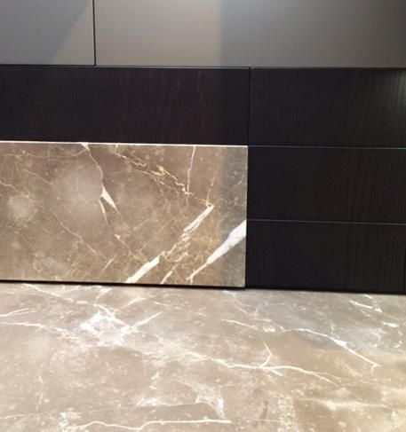 We've seen more veined marble, in minimal black & white, greys and browns for kitchens #Eurocucina