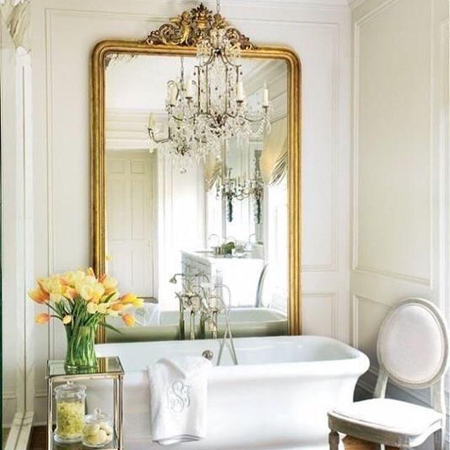 Parisian bathroom. The mirror, the floor, the shape of the bathtub.....perfect.