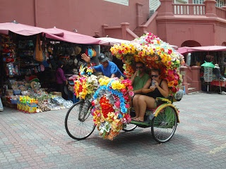 Rickshaw with tourists - Melaka, Malaysia
