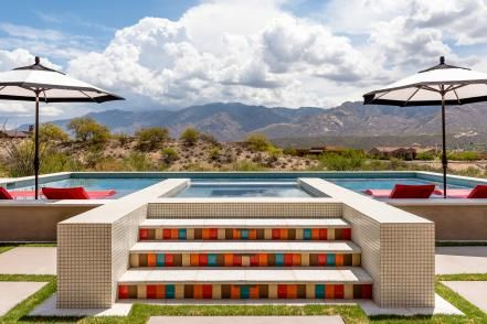 In this warm and welcoming outdoor space from Kathryn Prideaux, bold hues such as turquoise, red and orange echo the beauty of the Arizona desert. Colorful tiles and patterns add Southwestern flair to the pool and dining area.