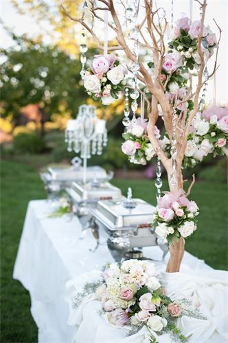 Wedding buffet table decorations ideas: Elegant effect with crystal strand & flowers. You can also make use of rhinestones or plastic gemstones as well.