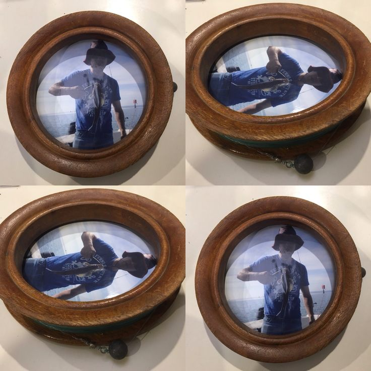 Old wooden fishing reel complete with hook, line and sinker,  turned photo frame.