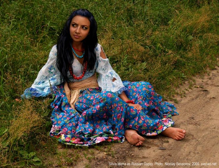 Gypsy girls' clothes, native Romani costume. A barefooted Gypsy girl