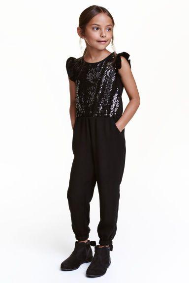 £12  Jumpsuit with sequins | H&M  http://www2.hm.com/en_gb/productpage.0428115001.html