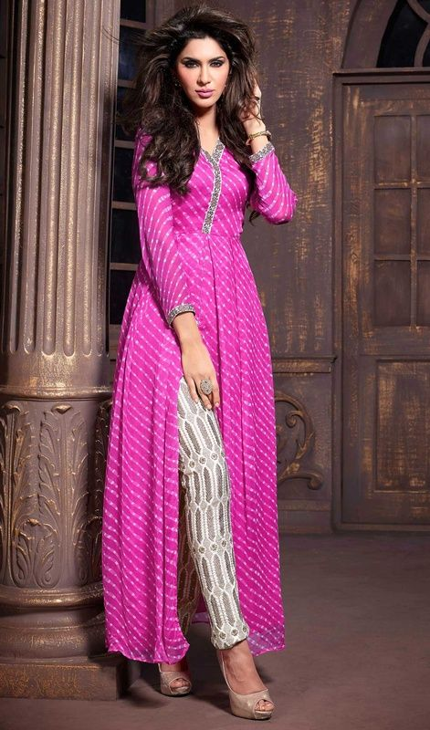 Captivate your onlookers attention dolled up in this pink shade chiffon pant style suit. The amazing dress creates a dramatic canvas with incredible resham and stones work. #FashionablePartyWearDress