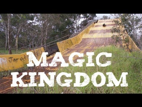 """This is the old slide at Magic Kingdom in Lansvale, NSW, Australia. The park operated in the 1970s, 1980s and early 1990s. There was a television commercial for the park featuring the song """"Magic"""" by the band Pilot, I would dearly love to see this ad again if somebody has it somewhere. The land is now empty, with only the giant dry slide, the big shoe house (not a ride) in the middle of the lake (natural) and toilets (both male and female) remaining."""