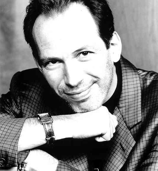 For the many of you who don't know, this is Hans Zimmer, he is my favorite composer because I believe he is simply the best (probably because he has done the scores for my favorite movies like: Sprit, Pirates of the Caribbean 2,3,4, The Lion King, and Sherlock Holmes). Any questions?
