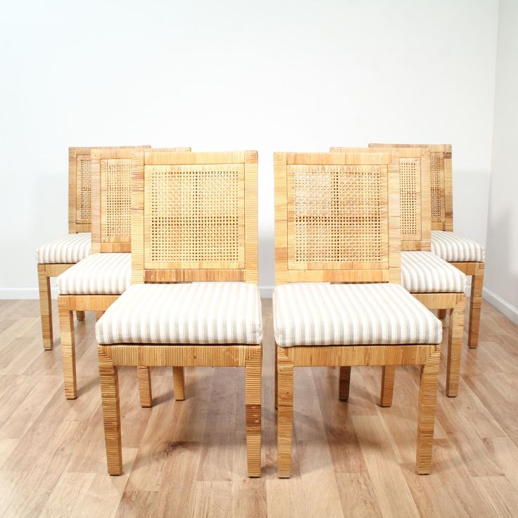 This set of 6 tropical chairs are featured in a durable woven rattan with a light blonde wood finish. These dining chairs are in great condition with woven wicker backs, simple straight legs and white upholstered cushions in gray and yellow stripes. Perfect for formal and casual dining indoors or outdoors! #tropical #chairs #diningchair #sandiegovintage #vintagefurniture