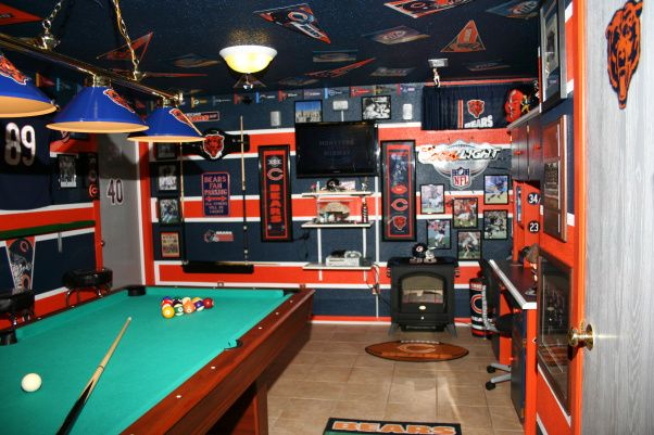 The Chicago Bears cave, This is my Chicago Bears basement/man cave! It has taken me over 100 hours to paint it. I used 12 rolls of blue painters tape. 7 tubes of paintable caulking! The walls were heavily textured, so to make the lines sharp and crisp I had to caulk over each tape line. The Bear head on the wall is not a Fat Head. It was done free hand from a picture. I