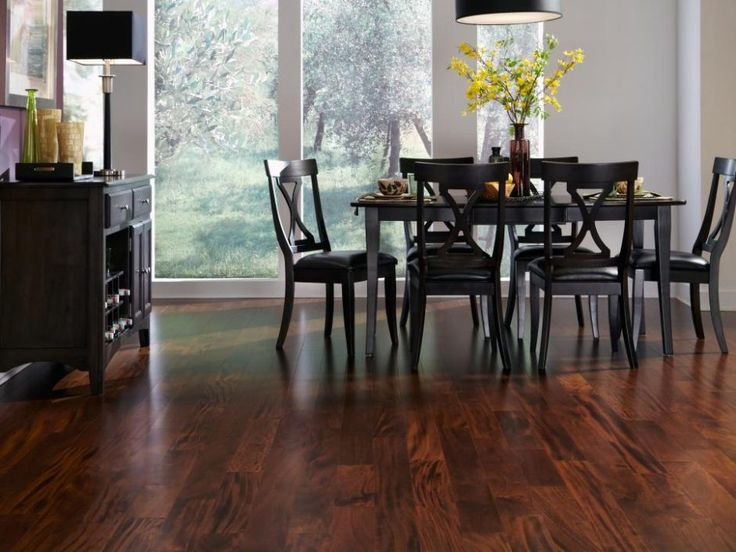 Dining Room: Transitional Black And White Dining Room With Wood Flooring. black dining table. rectangular table. black dining chair. wood flooring. dark wooden chest. black lampshade.