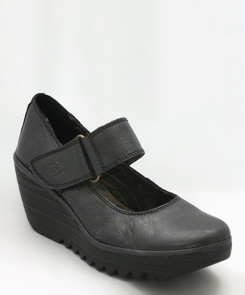 This+wedge-heeled+mary+jane+silhouette+flaunts+an+adjustable+hook+and+loop+strap+across+the+rich+leather+upper,+making+this+stacked+stepper+the+perfect+blend+of+sweet+and+sassy.