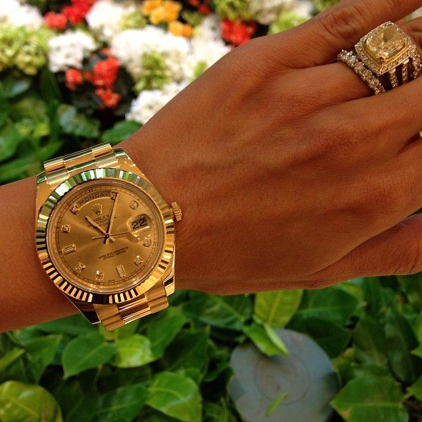 Blingy.. Rolex watch, with the blingin wedding ring! :)
