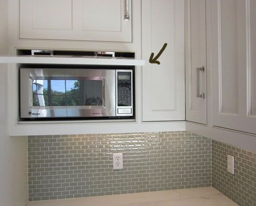 I love the built-in microwave. Also noteworthy: the small-scale subway tile. (I'm thinking it's very Ann Sacks like.)