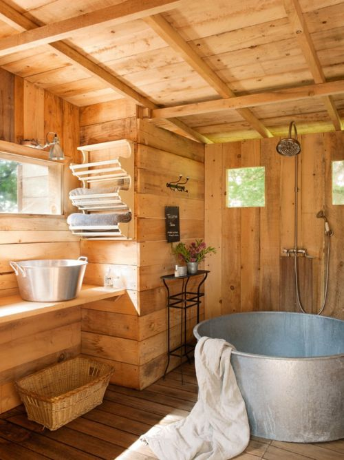 blue bathroom...- minimalist rustic tin roof back wall..... tile floor and shower metal tub