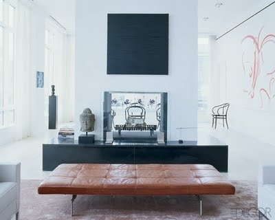 LOVE that ottoman/coffee table.