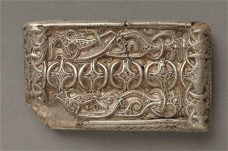 Part of a Viking era clothing buckle in silver found in Ödeshög, Sweden