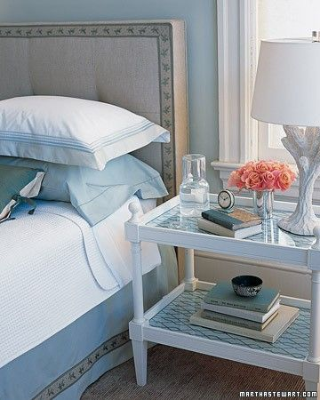 Tips for Decorating with Blue - 1. A sedate fabric headboard is easily dressed up by attaching a wide edging of cotton-linen tape trim with fabric glue. 2. There's no need to buy a whole new set of linens to vary the vibe in a bedroom. A few deep-colored items, such as pillowcases and accent pillows, provide a soft foil to crisp white sheets and a coverlet. 3. To amplify a side table, slip a patterned wallpaper under glass.
