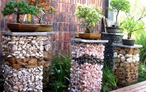 Gabion pillars to display unique Bonsais, galvanized wire baskets, filled with different colored stones and pebbles, creating a unique, understated effect
