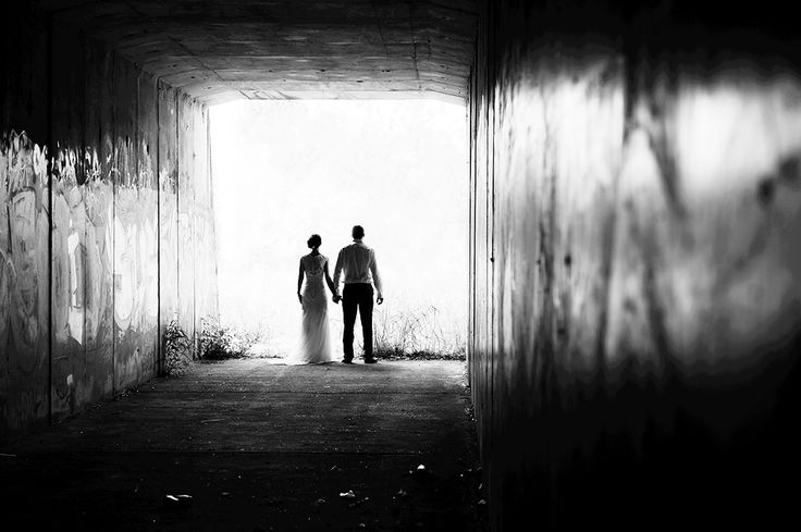 This photo is in the style of Chiaroscuro's work, and is Light and Shade. I like that it represents that the couples past may have been dark but their future together is bright and happy. The image was created using a dark, unlit tunnel with a bright light at the other side, to create the shade around the couple.