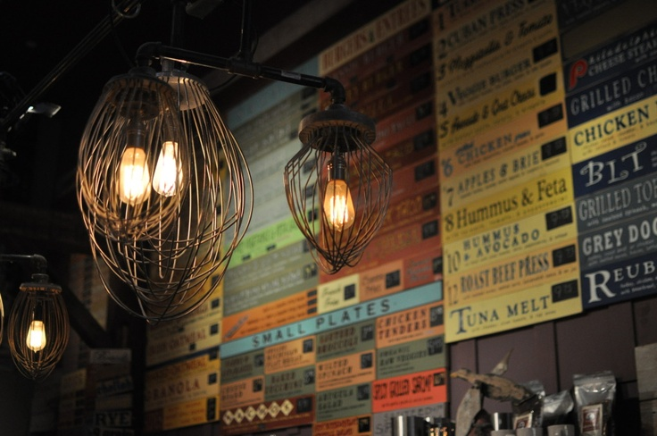 The Grey Dog Cafe, NYC. Industrial lights and eclectic signs for the menu.