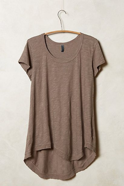 I have one sort of like this in purple and I love it. So comfortable. Dress up or down. Not just a regular tee.