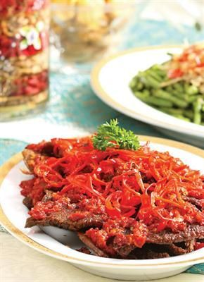 Dendeng Balado: a beef served with a hot chilli sauce and Gulai Daun Pakis - its fern tips cooked with coconut milk or red snapper curries. http://foodmenuideas.blogspot.com/2013/10/indonesian-food-getting-to-know.html