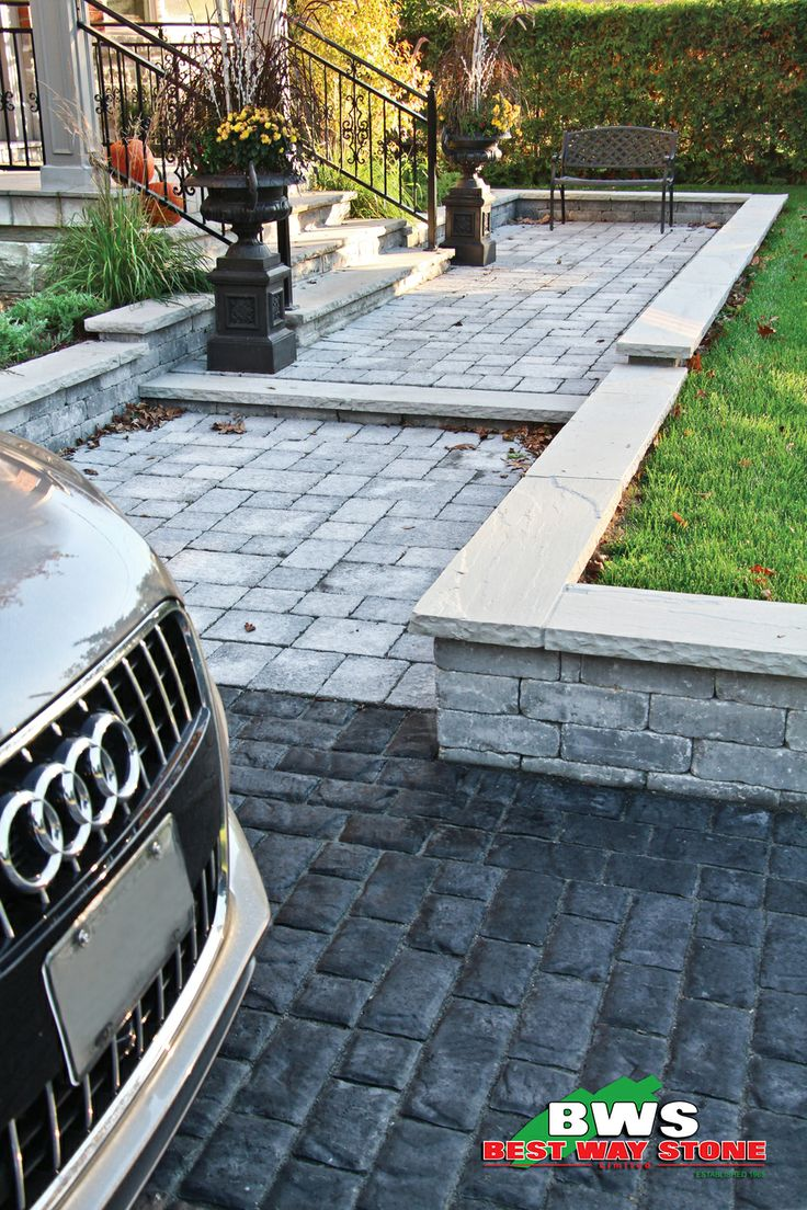 Best Way Stone > Paver: Bellagio Antico (Grey Mix) walkway with Corso (Ultra Black) driveway. Wall - Antico Stacker (Grey Mix). #outdoor #landscape #walkway #entrance available at our store at 3500 Mavis Rd, Mississauga, ON L5C 1T8
