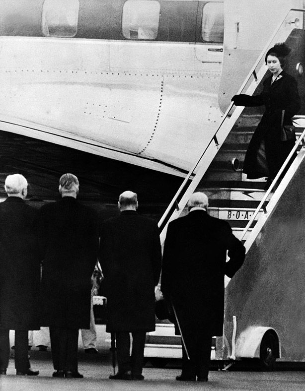 Queen Elizabeth II in 1952 being greeted by Winston Churchill, Clement Attlee, Anthony Eden and Frederick Marquis 2 days after she was proclaimed sovereign after her father's death in Kenya.