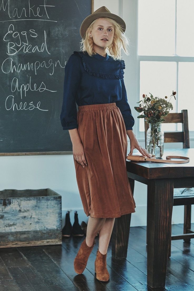 Nona Skirt  Midi skirt with elastic waist and pockets. Made from cupro this super soft skirt has great drape and flow.     100% Cupro   27 in below waist   Made in the USA  Dry Clean Only
