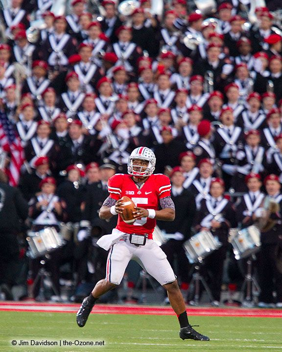 As The Bast Damn Band In The Land looks on, Braxton Miller looks for a receiver downfield vs. Wisconsin. Photo by Jim Davidson of TheOzone.net.
