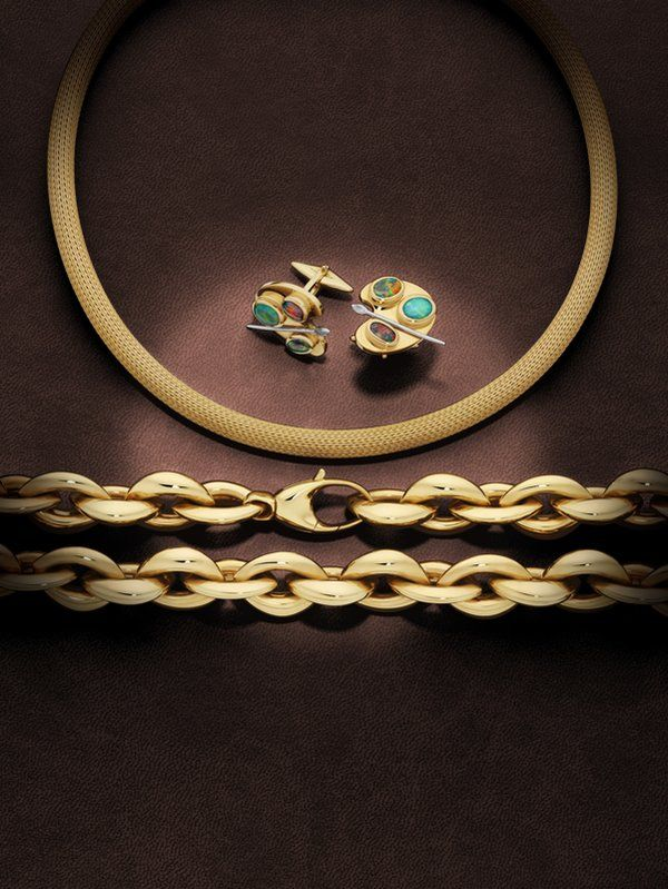 Opal cufflinks in an artist's pallette design, pictured above a woven-cable style, omega necklet and a striking large gold chain necklace .  (@Giulians_Gems)   Twitter