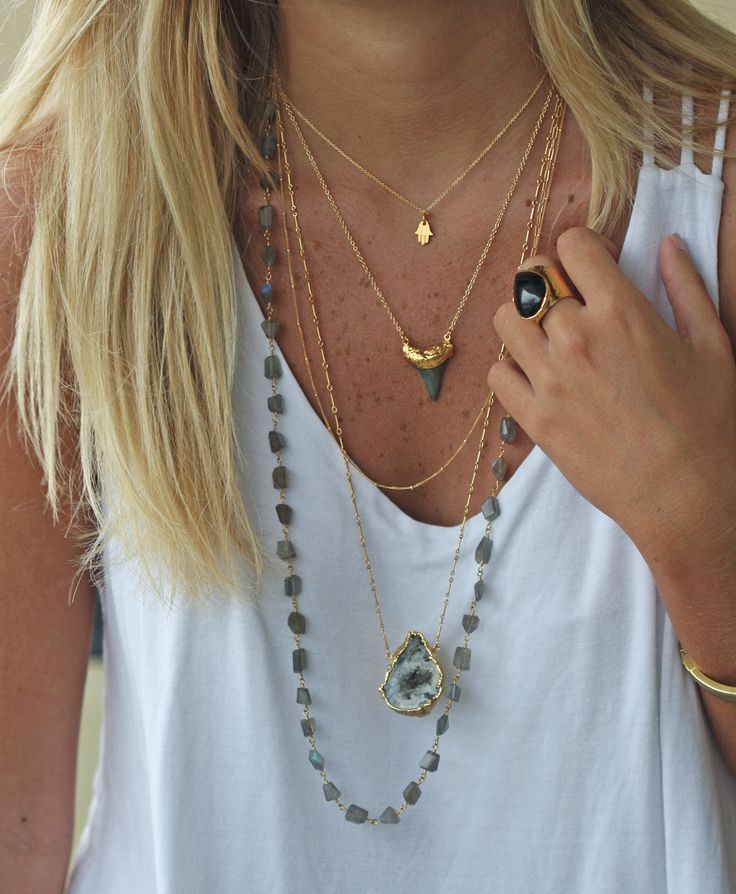 """This necklace is guaranteed to add a bit of """"bite"""" to your jewelry repertoire. The pendant is just stunning! We used a real dark shark tooth dipped in 24k gold. It's perfect for layering! It's edgy &"""