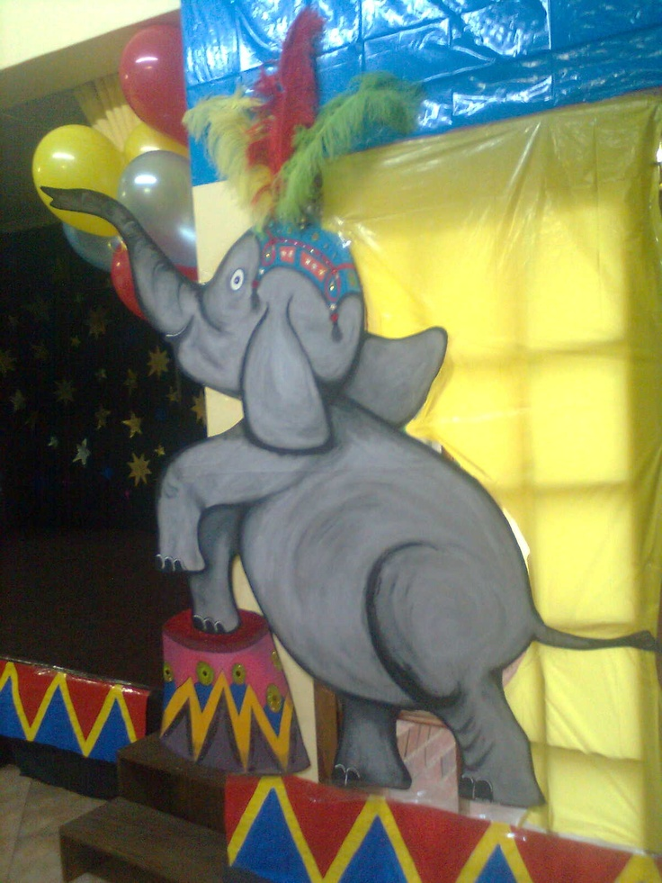2m tall elephant painted on fabric and glue to cardboard with real feathers.