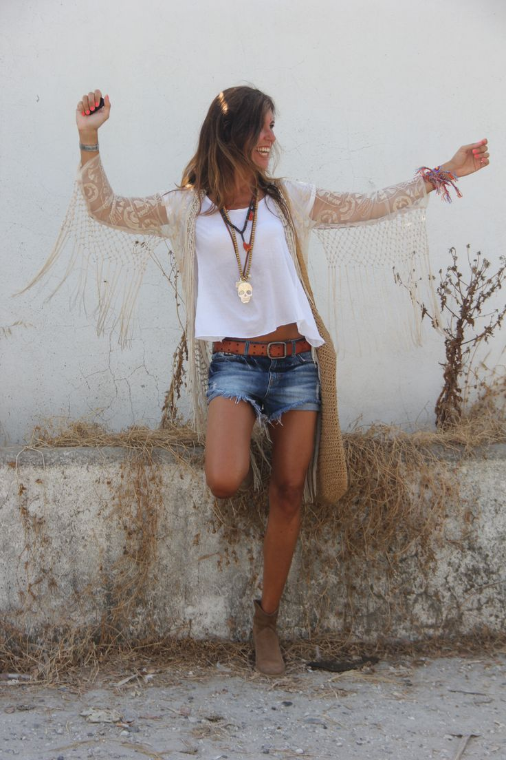 Fringe lace kimono, denim cut-offs and layered boho necklaces.