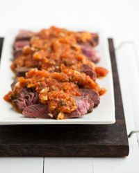 In Italy, the briefly cooked fresh tomato sauce called pizzaiola is traditionally served atop steak. We use sirloin, but if you'd prefer to use flank steak or skirt steak, just reduce the cooking time. The sauce is also good on pasta.   Slideshows: Great Steak