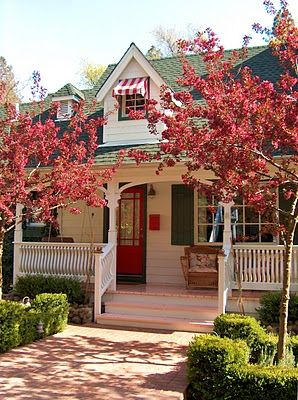 Love the red door and the red and white awning!