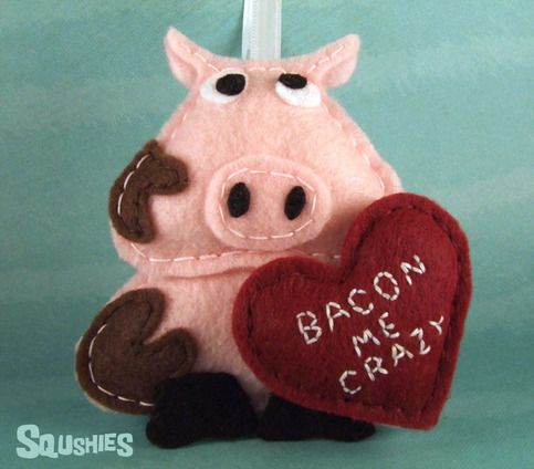 "Tell someone how you feel this Valentine's Day with a Squshie!    Sir Francis the Pig is a handmade felt ornament with an attached felt heart embroidered with the message ""Bacon Me Crazy"". Cute enough to give as a gift or be used as a fun gift topper.    Although he was never actually knighted, h..."
