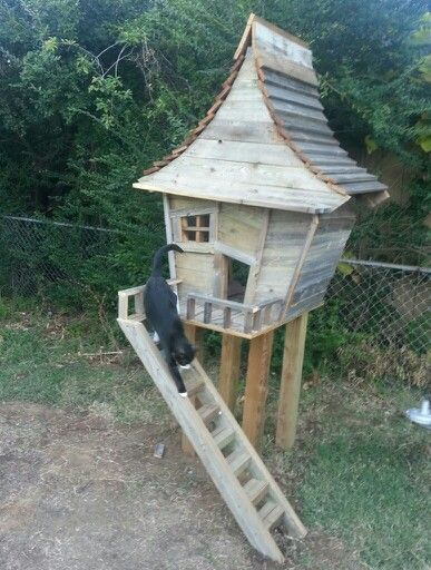 Awesome cat house made from reclaimed fence wood.